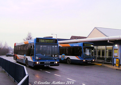 A pair of Optare Excels: 35011 (YN51VHW) off to Worksop, 35012 (YN51VHX) waiting to take up a journey to Rotherham