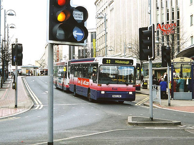 First 40457 (M418VHE), a Plaxton bodied Volvo B6 is framed by traffic lights on Angel Street