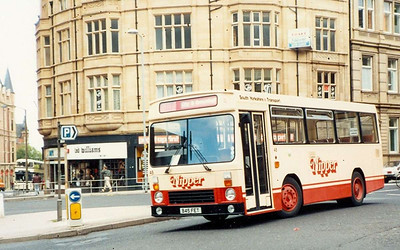 South Yorkshire Transport had a batch of 14 Optare bodied Dennis Domino for low frequency services in Sheffiel dand Rotherham. One of these, 45 (B45FET) is seen turning from Leopold Street into Church Street on 6th August 1985. Shefifeld Transport liveried 1737 can be seen on CHurch Street.
