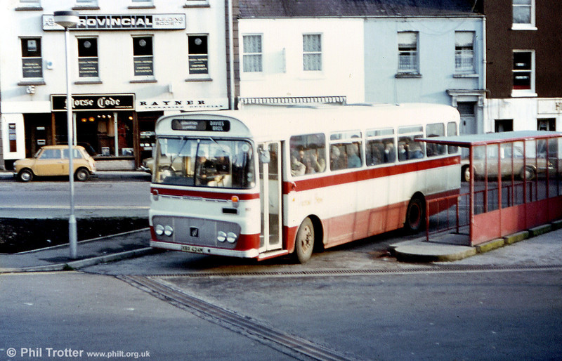 Davies Bros. Bedford YRQ/Willowbrook DP45F XBX 424M at Carmarthen.