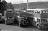 Three generations of Pontypridd/Taff-Ely double deckers appear in this view. At the centre is 1943 Bristol K6A/Park Royal H30/26R 40 (FNY 933).