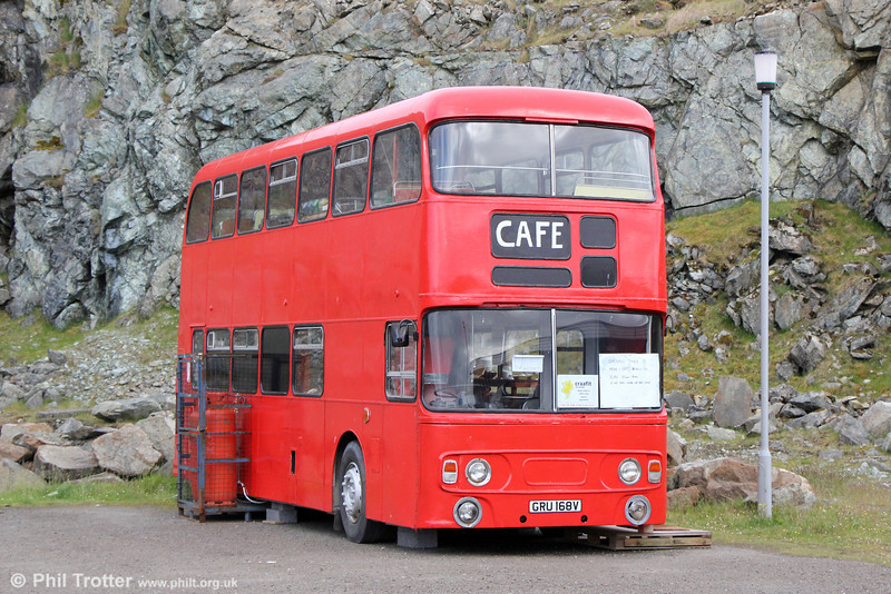 Former Bournemouth 168 (GRU 168V), a Leyland Fleetline/Alexander H43/31F now serving as a cafe at Belmont Ferry Terminal, Unst, Shetland.