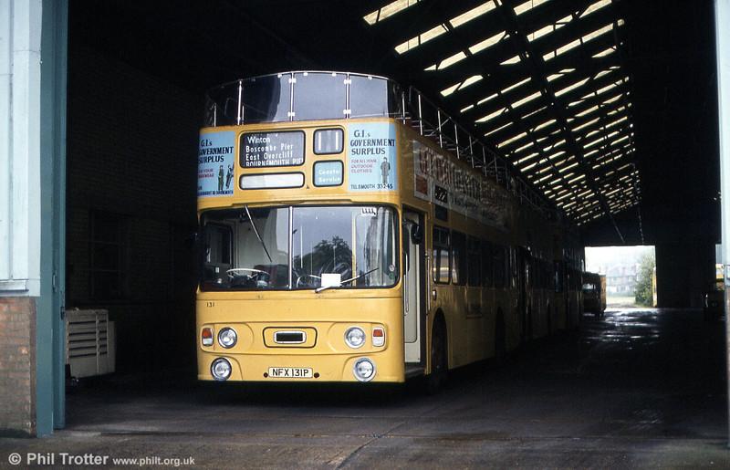 Bournemouth 'Yellow Buses' 131 (NFX 131P), a Daimler CRL6-30 / Alexander CO43/31F at Mallard Road depot in June 1984.