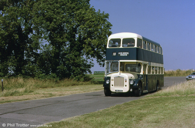 Former Swindon Corporation JAM 145E is a 1967 Daimler CV6G-30/Northern Counties H30/40F. Photographed running at an open day at Wroughton Airfield in 2001.