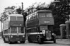 Llanelly 44 (CBX 910) a 1946 Karrier W/Park Royal H30/26R passes SWT AEC Regent ACY 7 which was engaged on retraining drivers to work on motorbuses prior to the closure of the system in 1952.