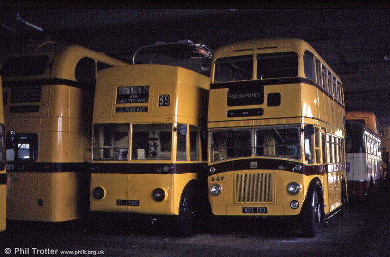 In the centre is Bournemouth 202 (ALJ 986), a 1935 Sunbeam MS2/Park Royal O40/29R at Mallard Road Depot in June 1984. The motorbus to the right is 247 (KEL 133), a 1950 Leyland Titan PD2/3/Weymann.