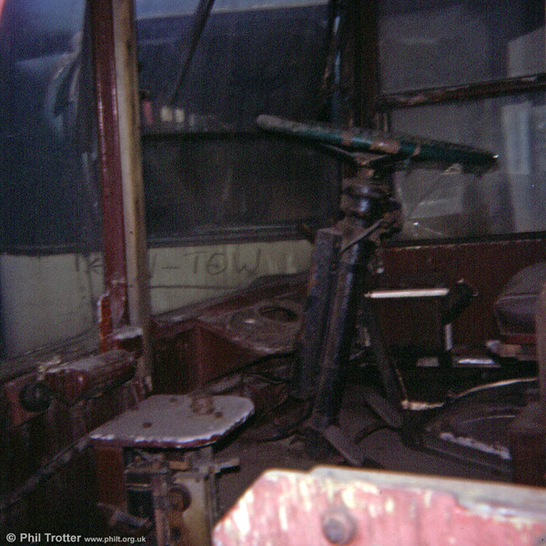 A view inside the cab of a former Cardiff Trolleybus at Way's scrapyard in 1974.