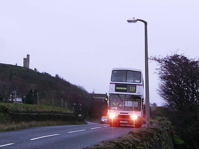 Alexander bodied Volvo Olympian 31151 (L27GAN) in poor light on Ashes Lane, runing empty after a Honley High School service, with Castle Hill behind. 24th November 2006