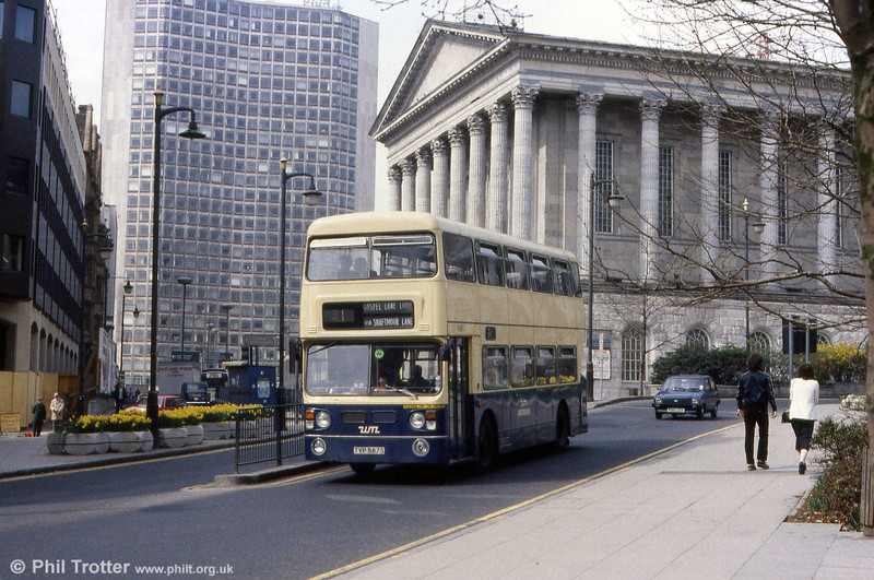 A mixture of modern and classical architecture forms a backdrop to WMPTE Fleetline 6887 (TVP 887S) at Victoria Square, Birmingham.