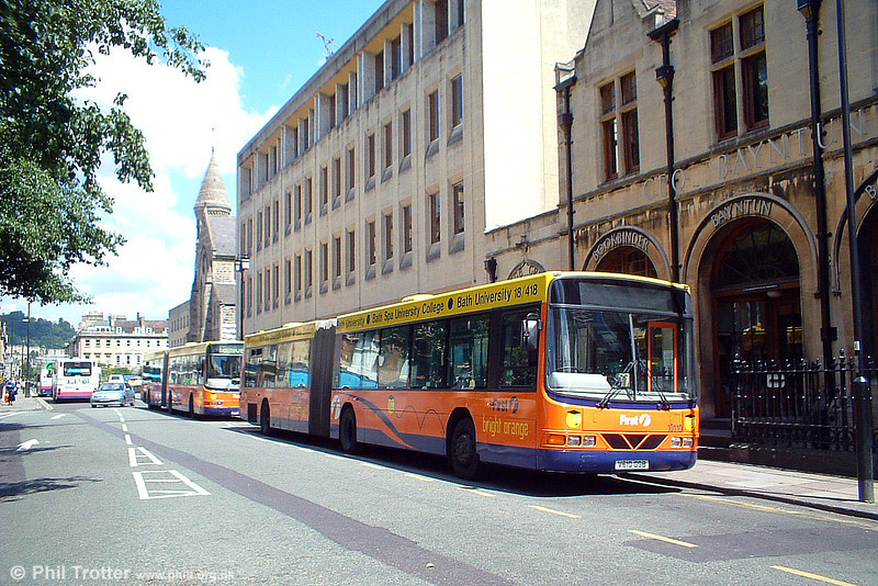 10110 (V610 GGB), a Volvo B10LA/Wright ADP55D is seen at Bath in 'Bright Orange' livery for services to Bath University on 25th June 2004.