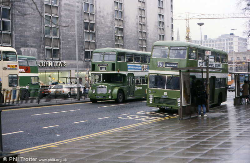 5004 (EHU 363K), a 1972 Bristol VRT/ECW H43/27D is passed by FLF6G 7236 (EHT 858C).