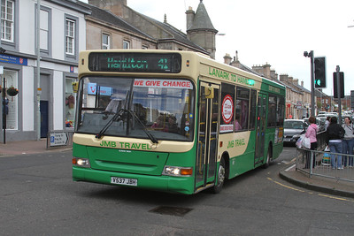 JMB Travel V537JBH retains its two door configuration and is seen here westbound on Main Street, Wishaw