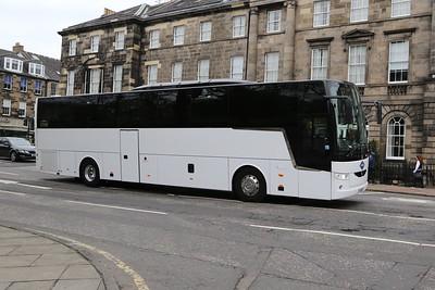 YJ18AVT was originally an Arriva demonstrator.  It's a Van Hool EX16M