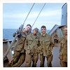 TB02 - Aboard the USNS Upshur: The guy at the far left leaning on the cable is Frank D Karvell from Philidelphia. He was the Company clerk Co B, 1st Bn, 6th Infantry.  Center (?),  and third from the left is Tom Bush (PA).