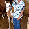Dale Bushue stands next the latest addition to the Bushue horse family. This unnamed and yet to be registered horse is now in training for competition. Charles Mills photo