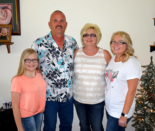 The Bushue family works together when it comes to showing their horses. Pictured from left, Makenzie Bushue, Dale Bushue, Julie Bushue and Mikala (Bushue) Lindsay. Charles Mills photo