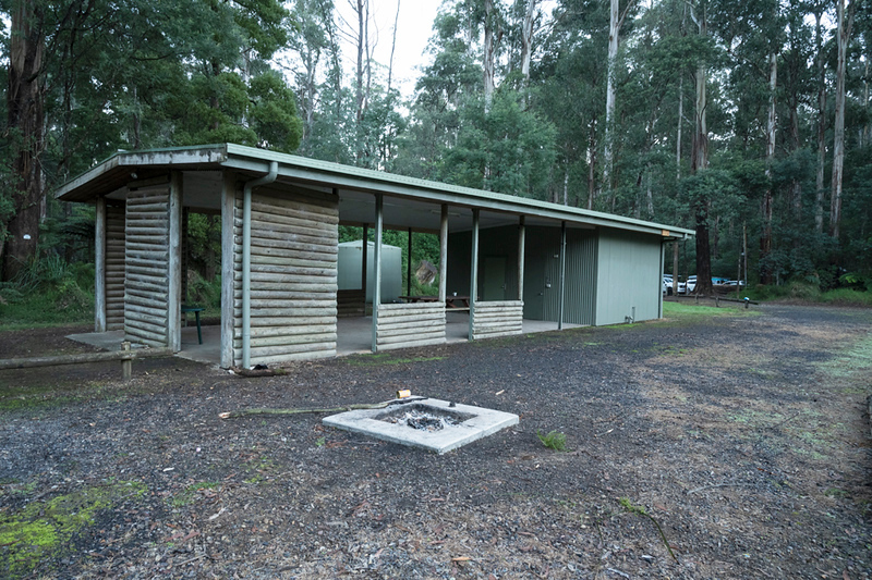 The toilet block and covered area with picnic table