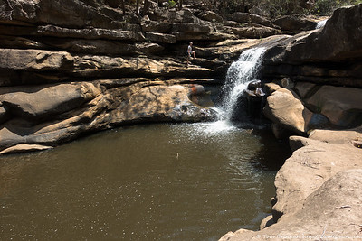 Rachel climbing the falls