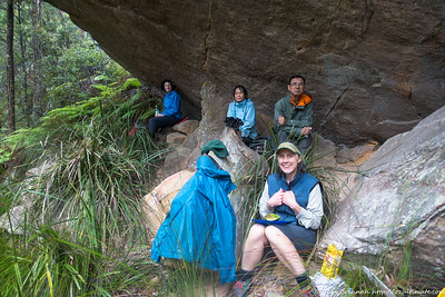 Out of the rain in a dry overhang for lunch