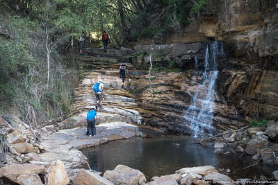 Scrambling up the falls in Hidden Creek