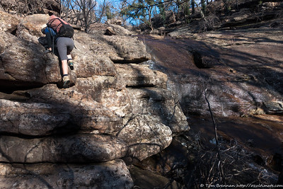Rachel scrambling up the main falls