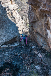 Climbing up a chasm to the top of the outcrop