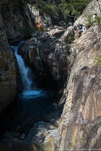 Rachel doing a dodgy looking scramble above the falls