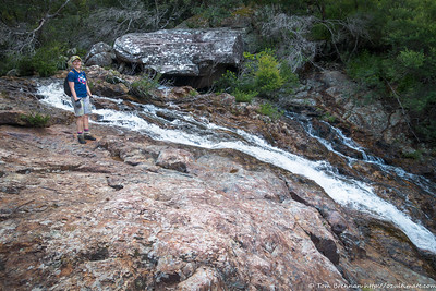 Rachel at the top of a long cascade