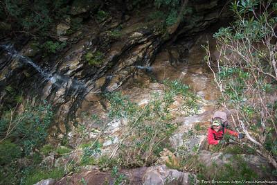 Rachel descending the trickier waterfall (also very slippery)