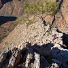 Descending the ridge above Hugh Gorge after the climb to the highest point. Stuart Imer. The Chewings Range. West MacDonnell Ranges National Park.