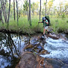 Day Two. Karen Tempest crossing a creek on the way to Crystal Falls, Jatbula Trail, Nitmiluk National Park, Northern Territory.