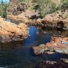 Day three. Karen Tempest relaxing on 17 Mile Creek. Jatbula Trail, Nitmiluk National Park, Northern Territory.