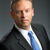 Executive Businessman headshot wearing blue necktie