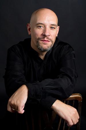 Portrait headshot of bald man