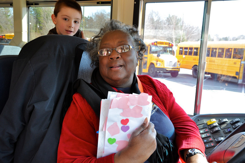Bus driver Mrs. Francis Johnson grateful recipient of Dalton Thomas, 7 Love card