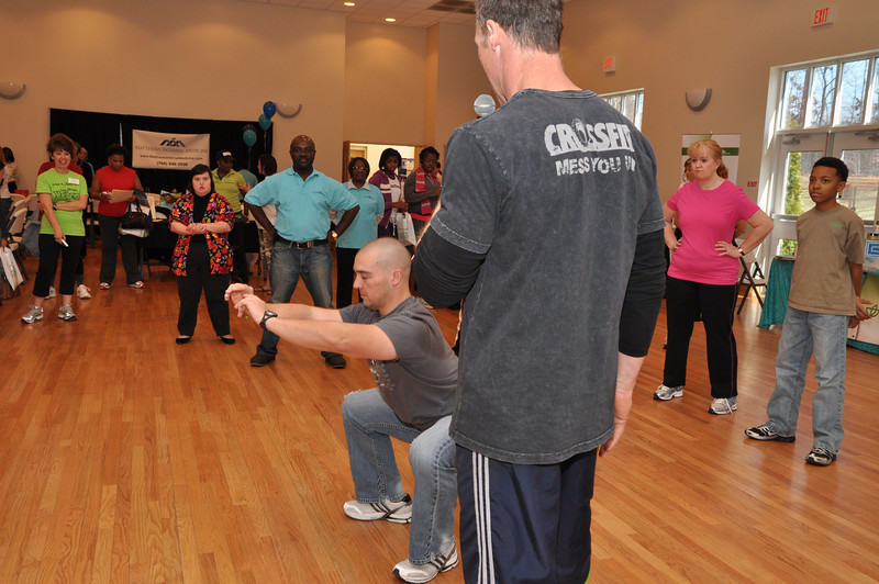 Crossfit Charlotte instructors Andy Hendel and Kelly Hargett demonstrates squat exercise