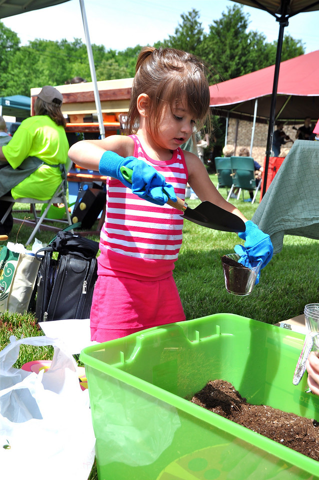 Ella Mroz learns what it is like to plant live vegetables.
