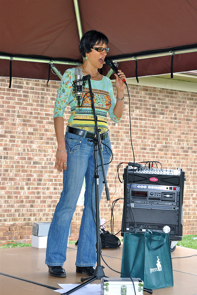 Soprano Virginia Gutierrez launches IT Earth Day singing the National Anthem.