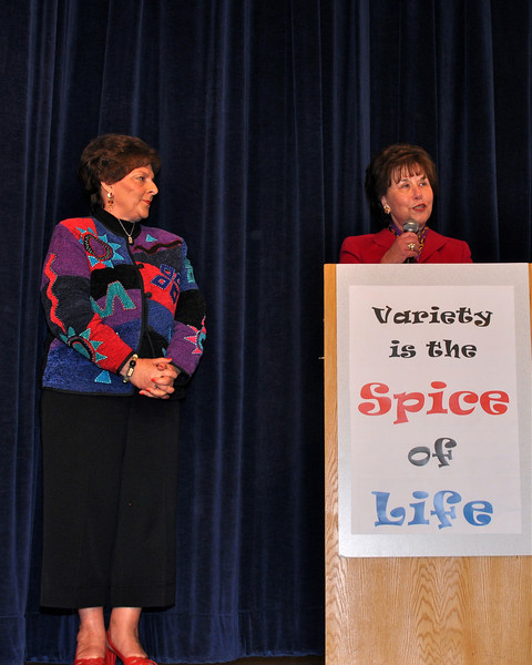 Judy Page, Vice President of Levine Board, stands by Mrs. Sandra Levine giving inspiration to the crowd.