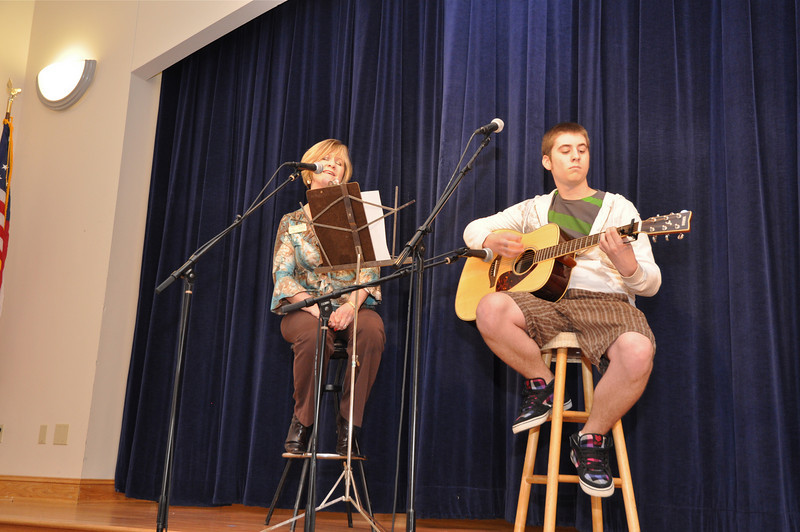 "Vocal presentation ""Kiss Me"" by Matthews Commissioner Nancy Moore and her son, Mitch LaFond, on guitar."