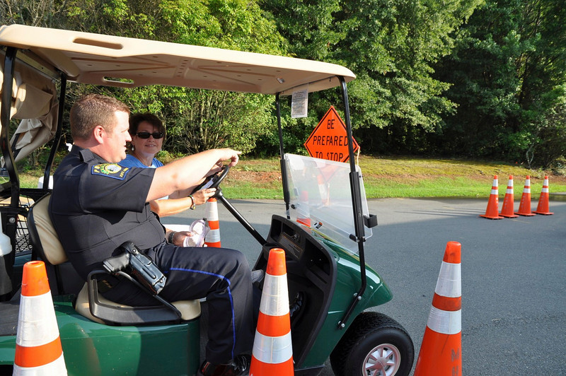 Officer Blevins demonstrates a DWI Simulation with Irene Furr, MH.
