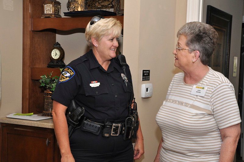 MPD DARE Officer Karen Green explains to Judy Moore that to be safe medications should be ground up, put in coffee grinds, and thrown away-kids will not have the opportunity to take them. Lock up meds. Educate your kids.