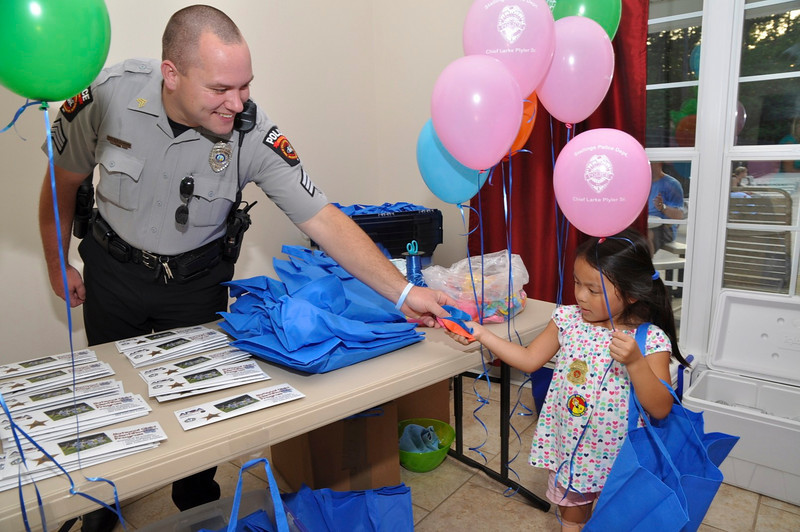 Sgt Cranford gives goodies to resident Emily Becker,6.