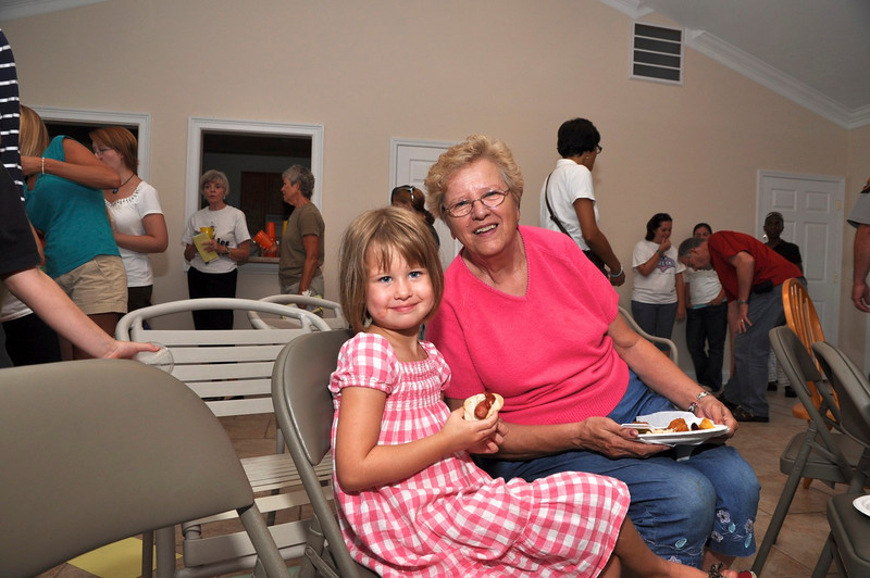 Judy Jordon enjoy a grilled hot dog with granddaughter Paige Davenport, 5, of Matthews.