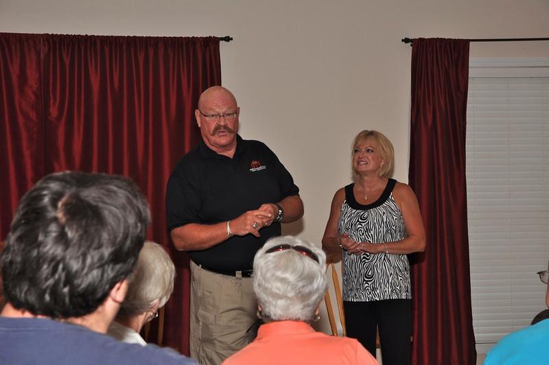 Dan Starks with Neighborhood Watch Committee Catherine Goodrich.