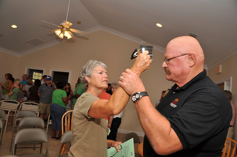 Safety Expert Dan Starks demonstrates the spiked keychain defense with resident Betty Pewtress.