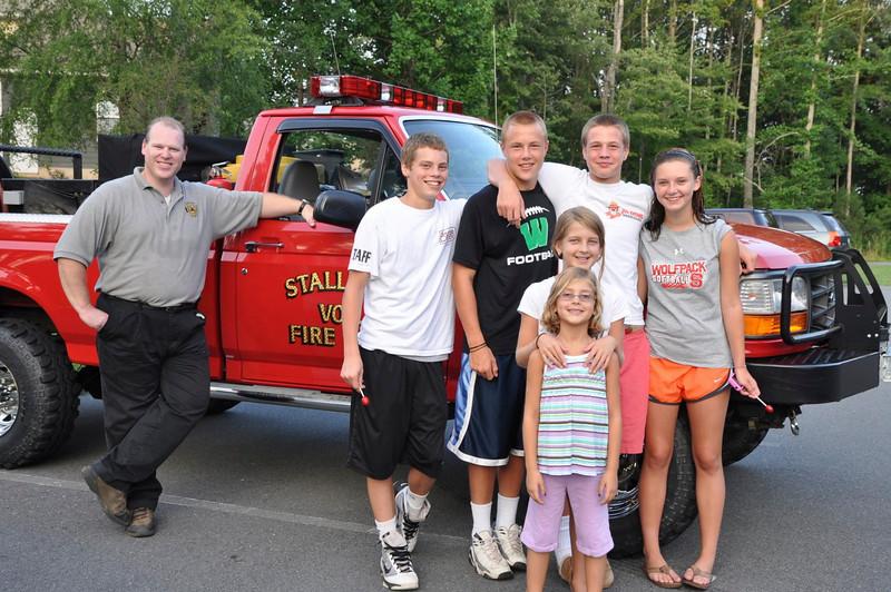 Firefighter Stegall with Evan Altizer,14,George William Ryan III,15, George Ryan,14, Kaylee Deese,14, Riley Dippert,9 Avery Dippert,9