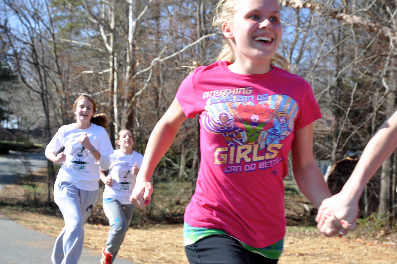 Kinsy Ollis,14 happy to reach the finish line with girlfriends!