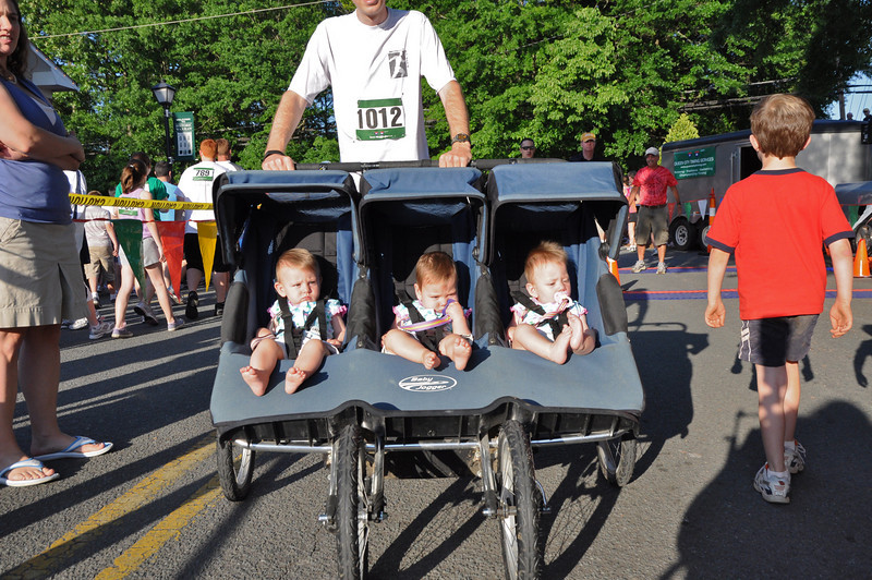 Scott Roux runs with his girls from Charlotte, Emma, Olivia, and Savanna all 9mos.-best seat in the house!