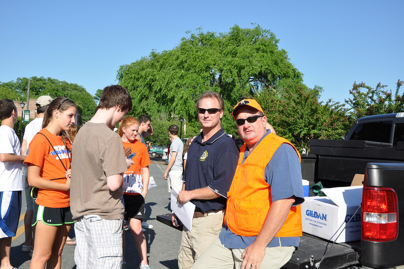Waxhaw Weddington Rotary Michael Litton and Parker Mills checking in traffic volunteers.